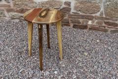 Walnut, sapele and elm circular side-table